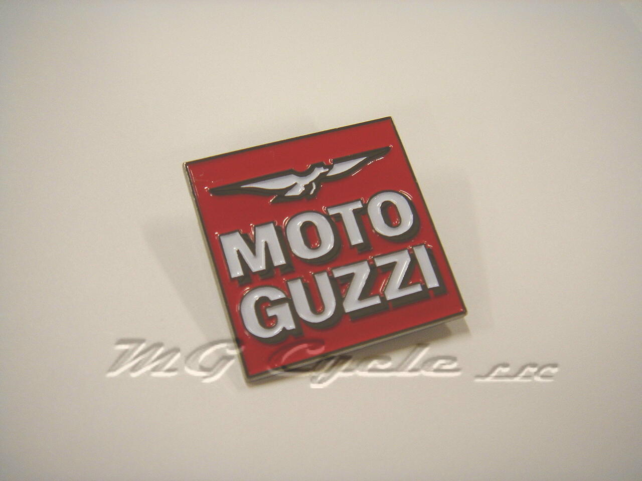 Lapel pin, De Tomaso era square logo, black and white on red