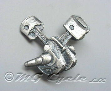 Lapel pin, pistons, rods, on crank